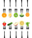 Fruits and vegetables on the forks Royalty Free Stock Photo