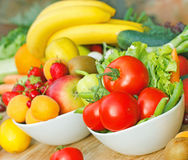 Fruits and vegetables. Fresh organic fruits and vegetables in a bowls stock images