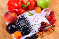 Fruits and vegetables with glucometer and notebook for notes, healthy food, diabetes royalty free stock photography