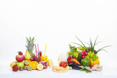 Fruits and vegetables healthy food. Healthy food diet fruits and vegetables on white table and white background with fresh juice in bottle stock image