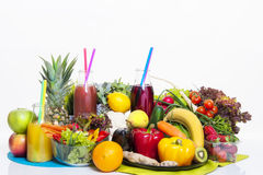 Fruits and vegetables healthy food. Healthy food diet fruits and vegetables on white table and white background with fresh juice in bottle royalty free stock photography