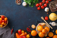 Fruits, vegetables and herbs on blue background. Rustic concept Stock Image