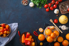 Fruits, vegetables and herbs on blue background. Rustic concept Stock Photography