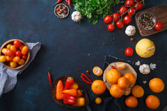 Fruits, vegetables and herbs on blue background. Rustic concept Stock Photos