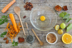 Fruits and vegetables ingredients on wooden table with kitchen utensils Stock Photos