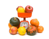 Fruits, vegetables and kitchen scale on white background Royalty Free Stock Images