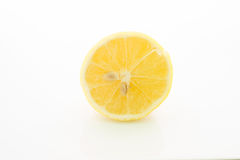 Fruits and vegetables. Lemon on a white surface and white background Stock Image