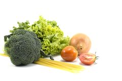 Fruits and vegetables,Lettuce, Broccoli,onion,tomatoes, spaghetti isolated.on white background.center.Health Royalty Free Stock Photos