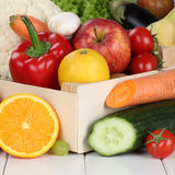 Fruits and vegetables like oranges, apple, tomato in box Royalty Free Stock Photos