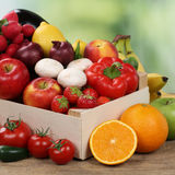 Fruits and vegetables like oranges, apples and tomatoes in box Stock Image