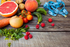 Fruits, vegetables and in measure tape Royalty Free Stock Photos