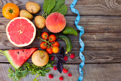 Fruits, vegetables and in measure tape Stock Photos