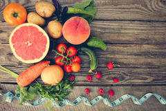 Fruits, vegetables and in measure tape in diet Stock Images