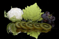 Fruits with vegetables. Multicolored fruits with vegetables on the mirror Royalty Free Stock Photo