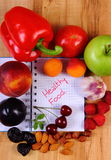 Fruits and vegetables with notebook, slimming and healthy food Stock Photography