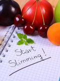 Fruits and vegetables with notebook, slimming and healthy food Stock Photo