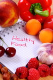 Fruits and vegetables with notebook, slimming and healthy food Stock Photos