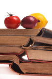 Fruits and vegetables on old books Royalty Free Stock Photos