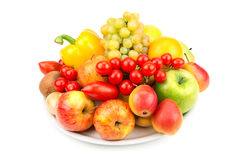 Fruits and vegetables on a plate Stock Image