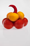 Fruits, vegetables pyramid. Vegetable pyramid: tomatoes, lemons and chilli pepper on the top Stock Images
