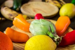 Fruits and vegetables at the rustic table. Healthy food stock photos