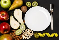 Fruits and vegetables on rustic wooden backround with space for text. Healthy eating, dieting, slimming and weigh loss concept. Ve Royalty Free Stock Photo