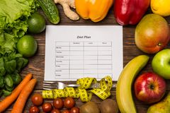 Fruits and vegetables on rustic wooden backround with space for text. Healthy eating, dieting, slimming and weigh loss concept. Ve Stock Photo