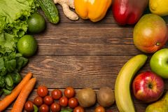 Fruits and vegetables on rustic wooden backround with space for text. Healthy eating, dieting, slimming and weigh loss concept. Ve Royalty Free Stock Images