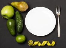 Fruits and vegetables on rustic wooden backround with space for text. Healthy eating, dieting, slimming and weigh loss concept. Ve Stock Photos