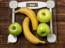 Fruits and vegetables on rustic wooden backround with space for text. Healthy eating, dieting, slimming and weigh loss concept. Ve Stock Image