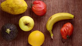 Fruits and vegetables on a rustic wooden table stock footage