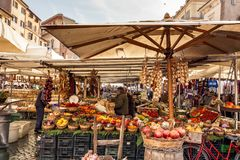 Fruits and vegetables on sale in the public market. Rome, Italy, february 18, 2017: fruits and vegetables on sale in the public market of Campo de Fiori, Rome Royalty Free Stock Photos
