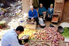 Fruits and vegetables seller directly beside garbadge dump, Morocco stock images