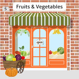 Fruits and vegetables shop. Local fruit and vegetables store building. Cart with vegetables at the fore. Vector illustration. EPS 10 Royalty Free Stock Photos