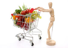 Fruits and vegetables in a shopping cart Stock Photos