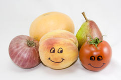 Fruits and vegetables smiling. Various fruits and vegetables, some animated on a white background Royalty Free Stock Image