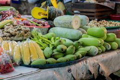 Fruits and vegetables sold in the bazaar. ginger,corn,mango,hatch,Green bell  peppers ,pumpkin. Fruits and vegetables sold in the bazaar. ginger,corn,mango,hatch Stock Image