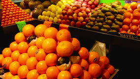 Fruits and vegetables on the Spanish market. BADALONA, SPAIN - MARCH 10, 2017: Fruits and vegetables on spanish market counter, La Salut Municipal market stock video