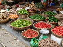 Fruits, vegetables, spicy peppers, seeds and spices for sale on the street Stock Photo