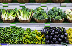 Fruits and vegetables on a supermarket shelf Royalty Free Stock Photos
