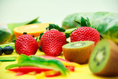 Fruits and vegetables on the table. Berries, blackberry, blueberry and strawberry on the plate Stock Photography