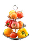 Fruits and vegetables on a vase isolated Royalty Free Stock Photos