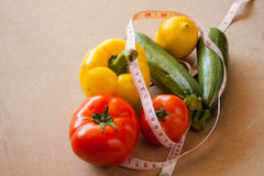 Fruits, vegetables, weight loss, and health care Stock Images