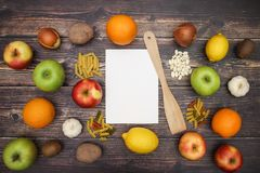 Fruits and vegetables and white paper for recipe.  royalty free stock photo