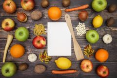 Fruits and vegetables with white paper for recipe.  stock images