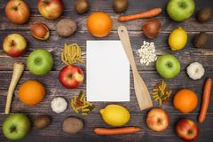 Fruits and vegetables with white paper on table.  royalty free stock photo