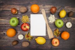 Fruits and vegetables with white paper on the table.  royalty free stock photography