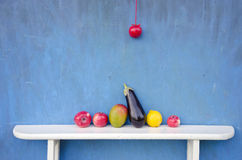 Fruits an vegetables on white wooden shelf Royalty Free Stock Photo
