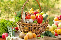 Fruits and vegetables. Wicker basket is full with fruits and vegetables royalty free stock image