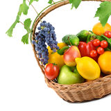 Fruits and vegetables in a wicker basket Stock Photos